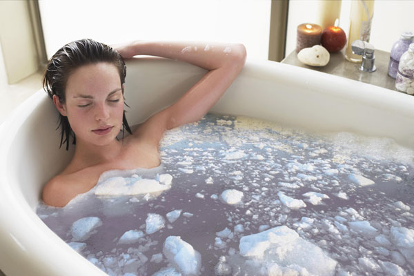 a woman enjoys bathing in a hot water